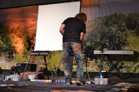 William Butler, artist from Camden, NJ, begins painting at the Downtown Church in Des Moines, IA.