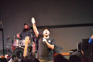 Marty worshiping and proclaiming God's truth to concert attenders
