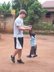 Ethan Oehler playing with his friend Esther in Uganda, Africa