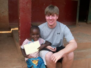 Ethan Oehler and his friend Esther near Kampala, Uganda in Africa